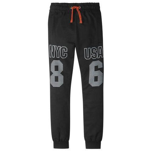 Spodnie dziecięce, Spodnie dresowe z nadrukiem bonprix czarny z nadrukiem
