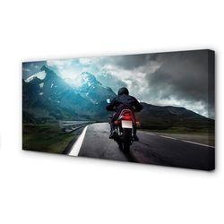 Obrazy na płótnie Motocykl góry droga człowiek niebo